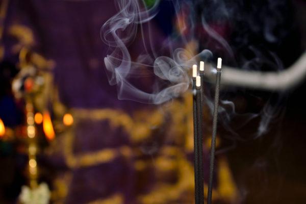 burning incense sticks with smoke
