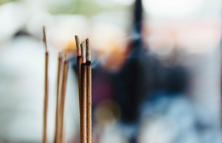 lit incense sticks