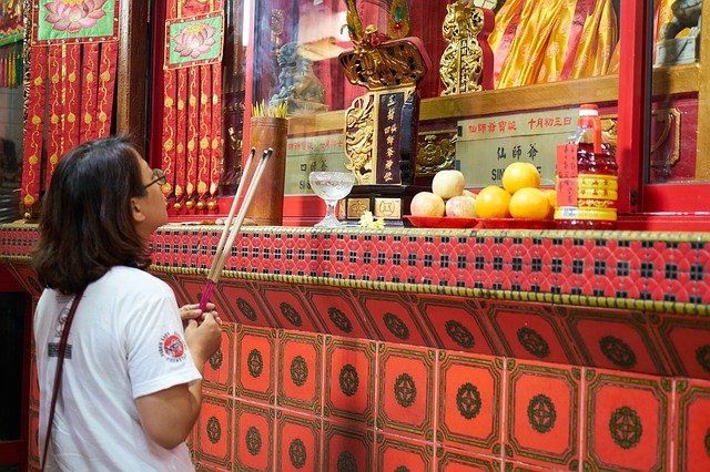 Lady Holding Incense Outside of a Temple